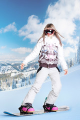 Image of happy girl on winter resort snowboarding there
