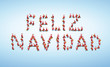 A lot of santas forming feliz navidad