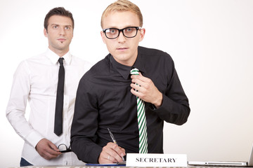 Young male secretaries at the front desk