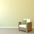 Armchair near empty wall.