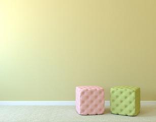 Two poufs near empty wall.