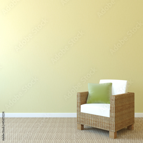 Armchair near empty wall.