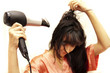 The woman dries hair the hair dryer