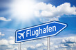 Blaues Schild mit Sonne und Flughafen
