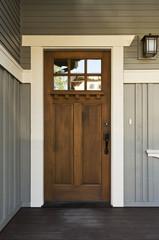 Dark wood front door of a home