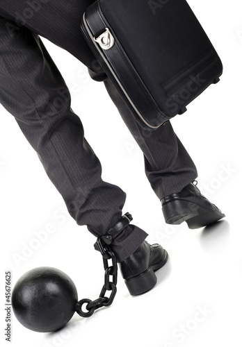 Ball and chain on businessman
