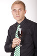 Young attractive businessman with glass of wine