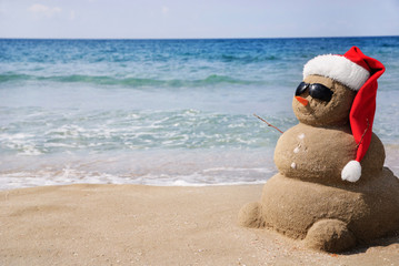 Snowman made out of sand. Holiday concept can be used for New Ye