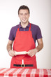 Young attractive male cook in apron