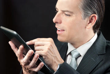 Businessman Uses Tablet, Close
