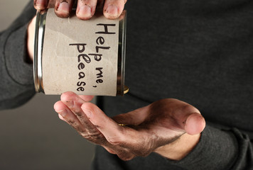 homeless pours money from bank, close-up
