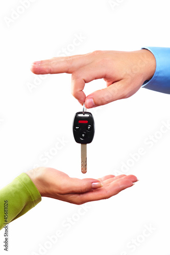 Hand with a car key.