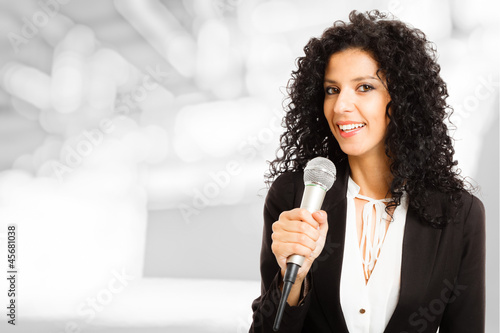 Woman speaking in a microphone