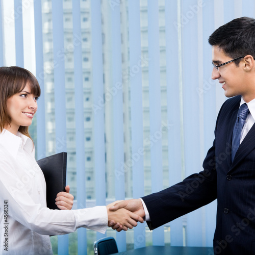 Happy businesspeople handshaking