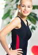 Cheerful woman in fitness wear indoors