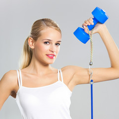 Woman with dumbbell and growth