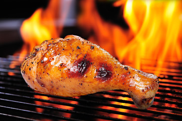 Grilled chicken leg on the grill.