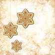 Christmas background with golden lights and gingerbread stars.