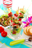 chicken and vegetable skewers served in glass