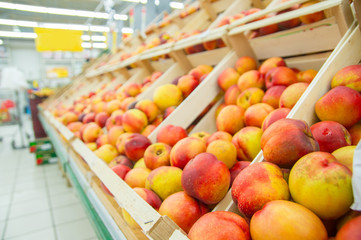 Nectarines in wood boxes in supermarket