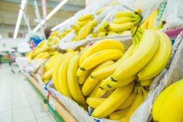 Bananas in boxes in supermarket