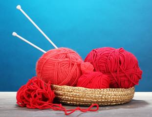 Red knittings yarns in basketon