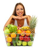 beautiful young woman with fruits and vegetables in shopping