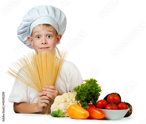 cook is holding raw spaghetti. isolated