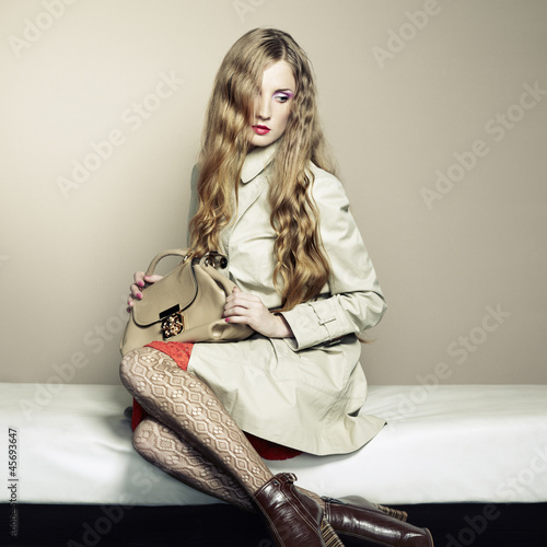 Portrait of a beautiful young woman with a handbag