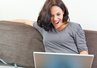 Cheerful woman in front of her laptop