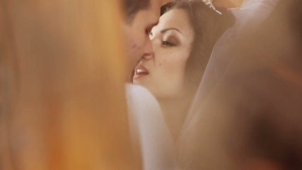 Wonderful young bride looking intently love into her husband
