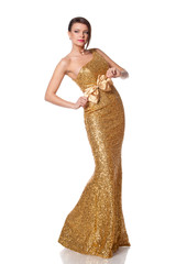 Beautiful woman in full length posing in long golden party dress