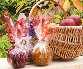 Caramel, chocolate, toffee and fresh red apples in garden