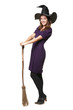 The  young beautiful witch with a broom and hat