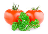 Two red juicy tomatoes and fresh parsley isolated on a white bac