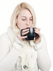 Young woman slurps a cup of tea - isolated
