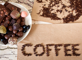 "still life of chocolate, coffee beans, candy, the word ""coffee"""