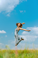 smiling young woman jumping