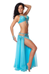 Belly dancer wearing a light blue costume