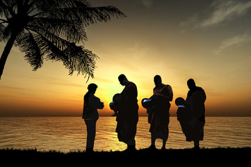 Silhouettes of monks on the beach, Thailand