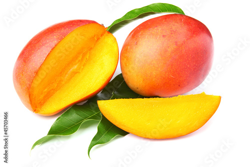 fresh mango fruit with cut and real mango leafs