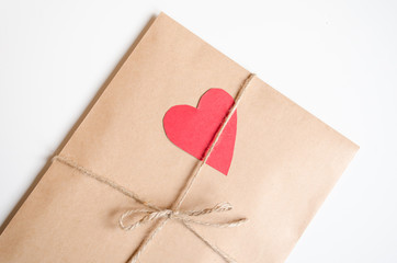 Kraft envelope with red heart