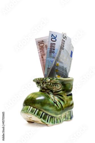 Geschenk. Dekoration Schuh mit Geld.