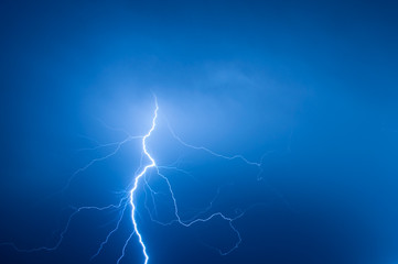lightning bolt striking the night sky