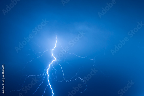 lightning bolt striking the night sky