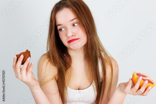 young beautiful girl with fruit and cake in her hands