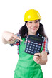 Woman builder with calculator on white
