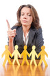 Businesswoman with paper people on white
