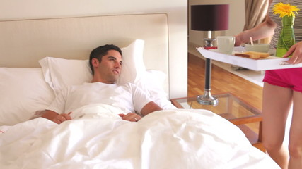 Woman Bringing Man Breakfast In Bed
