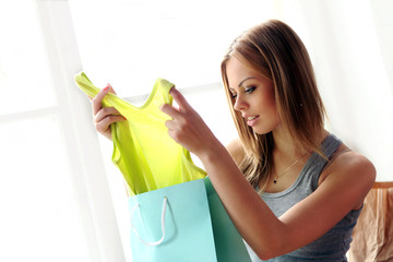 Woman viewing new purchases at home